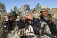 Soldiers Aiming Machine Guns Stock Photos