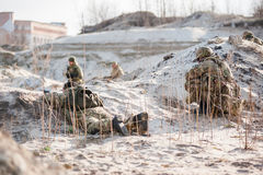 The soldiers in ambush. Two soldiers in an ambush awaiting the approach of the enemy stock photo