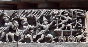 Soldiers of ancient indian army going for fight, relief of the 12th century Hoysaleshwara temple in Halebidu, India. Stock Image