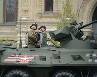 Soldiers on armored personnel carrier BTR-82A during a military parade dedicated to the Victory Day. Stock Photo