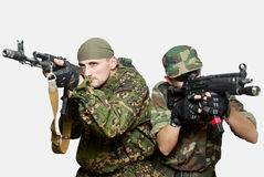 Soldiers with an automatic assault rifles Royalty Free Stock Image