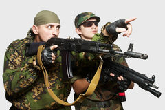 Soldiers with an automatic assault rifles Stock Photography