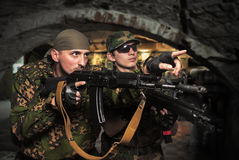 Soldiers with an automatic assault rifles Royalty Free Stock Photo