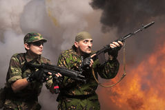 Soldiers with an automatic assault rifles Stock Images