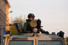 Soldiers. With automatic grenade launcher on the roof of the armored car Stock Photography