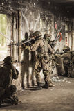 Soldiers with automatic weapons Royalty Free Stock Photos