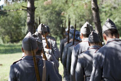 Soldiers from behind Royalty Free Stock Image