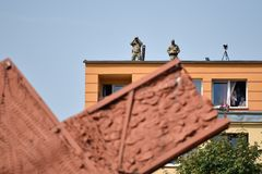 Soldiers with binoculars on the top of the building Stock Image