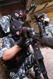 Soldiers in black masks targeting with guns Stock Photography
