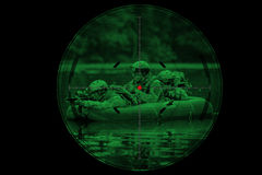 Soldiers in a boat sailing ahead. Operator in a boat sailing ahead royalty free stock images