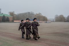 Students and soldiers marching and paying tribute royalty free stock images