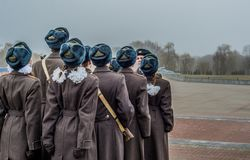 Students and soldiers marching and paying tribute royalty free stock photo