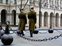 Soldiers at the Budapest Parliament in green winter uniform performing guard service stock image