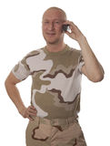 Soldiers calling on mobile phone Stock Photo