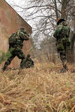 Soldiers in camouflage - action Royalty Free Stock Image