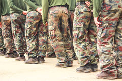 Soldiers in camouflage military uniform Stock Image
