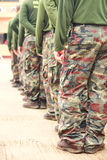 Soldiers in camouflage military uniform Stock Photos