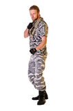 Soldiers in camouflage uniform. Muscular young soldier  in army clothes and camouflage paint. isolated on a white background Stock Photo