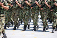 Soldiers with camouflage uniforms marching Royalty Free Stock Images