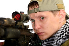 Soldiers in cap and scarf with a rifle Stock Photos