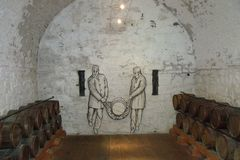 Soldiers carrying gunpowder keg. Gunpowder store at Dumbarton castle image of two soldiers carrying keg of gunpowder in castle battery whitewashed brick and royalty free stock images