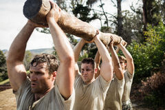 Soldiers carrying a tree log. In boot camp Royalty Free Stock Images