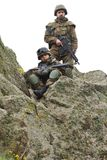 Soldiers on the cliff Stock Images