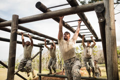 Soldiers climbing monkey bars. In boot camp Royalty Free Stock Photography