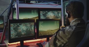 Soldiers controlling rocket launch on computer