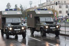 Soldiers of Czech Army are riding ambulance  on military parade in Prague, Czech Republic. Soldiers of Czech Army are riding ambulance on military parade in stock image