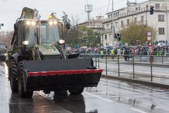 Soldiers of Czech Army are riding backhoe loader JCB 4CX on military parade. European street, Prague-October 28, 2018: Soldiers of Czech Army are riding backhoe stock images