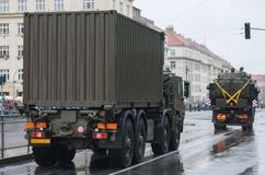 Soldiers of Czech Army are riding military truck with container. On military parade  in Prague, Czech Republic royalty free stock image