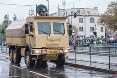 Soldiers of Czech Army are riding military vehicle with armored cab. European street, Prague-October 28, 2018: Soldiers of Czech Army are riding military vehicle royalty free stock photos