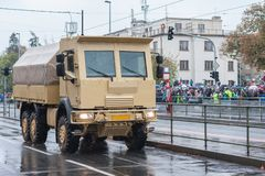 Soldiers of Czech Army are riding military vehicle with armored cab. On military parade  in Prague, Czech Republic stock images