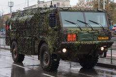 Soldiers of Czech Army are riding tank truck on military parade. European street, Prague-October 28, 2018: Soldiers of Czech Army are riding tank truck on royalty free stock photo