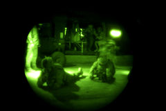 Soldiers Dismount Helicopter in Iraq. Soldiers rehearse unloading a helicopter before getting air lifted to the landing zone for their mission in Iraq.  Viewed Royalty Free Stock Photography
