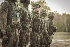 Soldiers at drill. Soldiers at rifle drill on training groung Stock Image