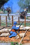 Soldiers fight on the battle field in fume. Stock Image