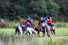 Soldiers fight on horses. Stock Image