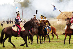 Soldiers fight riding horses Stock Photos