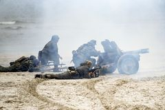 Soldiers fighting on the beach during the reconstruction of the historical battle with WWII.  royalty free stock photo