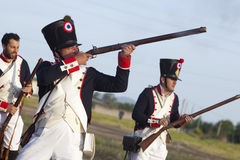 Soldiers fire muskets Stock Photo