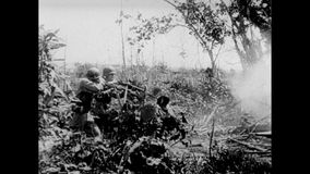 Soldiers firing into bushes, 1940s stock footage