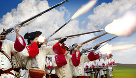 Soldiers Firing Their Muskets In A Battlefield Royalty Free Stock Photos