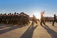 Soldiers with flag marching on parade Stock Photography