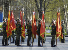 Soldiers with flags stock photos