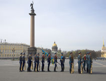 Soldiers with flags in front of the rehearsal of the Victory parade. Saint Petersburg Royalty Free Stock Images