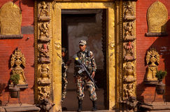 Soldiers in front of the palace. Nepal, Kathmandu Valley bhadgaon, ancient palaces Mara dynasty palace, the main entrance of the gold-copper as magnificent Stock Photography