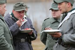 Soldiers of the Germans of the Second World War. Belarus, Gomel, Gomel region 11.21.2015. Reconstruction of the battle of the Second World War. Soldier lunch stock image