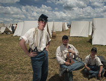 Soldiers at Gettysburg. Reenactors in a tent city between battles at the 150th anniversary of the battle of Gettysburg, Pennsylvania Royalty Free Stock Photo